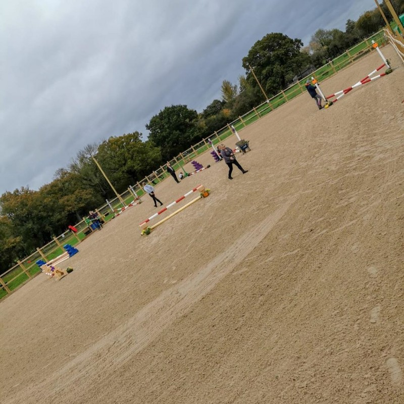 Picture of setting up jumping course